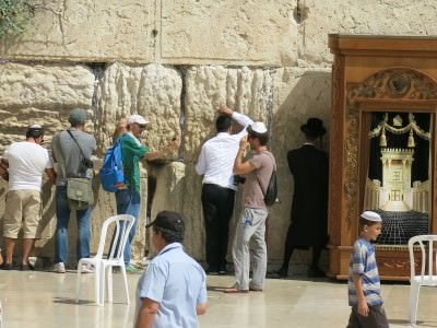 Touching the Western Wall in Jerusalem.