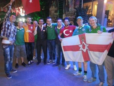 Posing outside the stadium with Turkish fans in Adana.