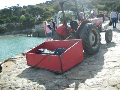 "On arrival at Herm, a tractor can take your bags to the ""capital"" or the hotel."