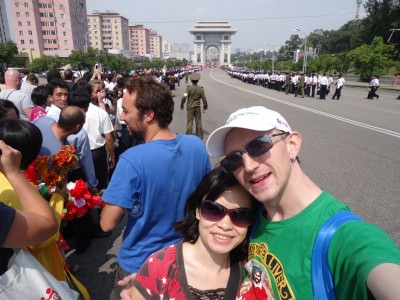 Watching the National Day parade with the Arc de Triomph in behind.