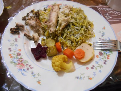 The main meal including vegetables, rice and fish.