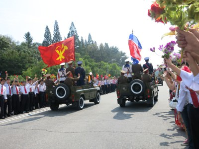 Communist and North Korea flags during the National Day Parade