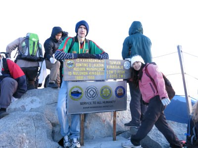 Panny and I plus hundreds of others at the peak of Mount Kinabalu in Malaysia