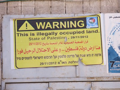 We're now in Palestine and this land is illegally occupied by Israel.