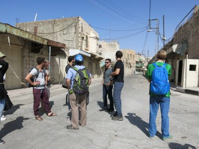 Our group assembles on Apartheid Street in between H1 and H2, Hebron.