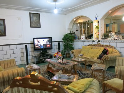Watching TV during afternoon tea in Shahr-e Kord, Iran.