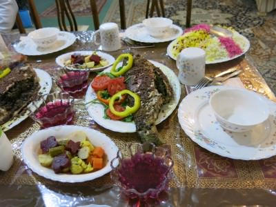 Fish dish, jelly, vegetables, rice, bread. Endless food in Shahr-e Kord, Iran.