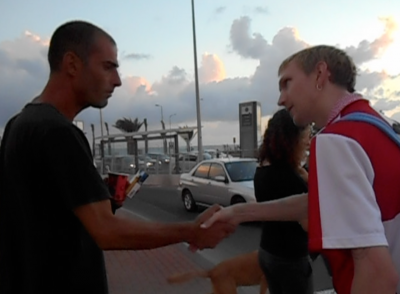 Shaking hands and interviewing Shomi, the Hero of Israel, in Haifa