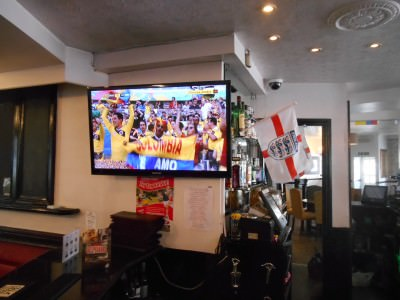 Watching Greece v. Colombia in the Ruse Bar in London.