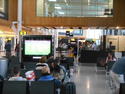 At my gate in Heathrow Terminal 1 about to board for Rio watching the France v. Honduras match!