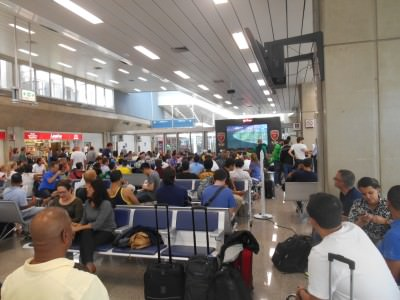 The crowd watching the Germany v. Portugal match in Rio Airport.