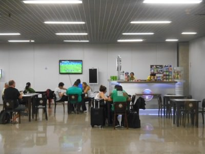 A bar in Fortaleza Airport showing the football.