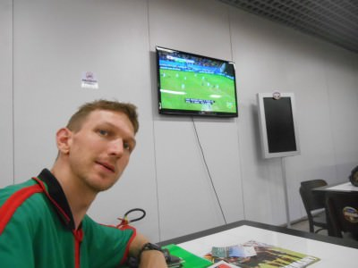 By the boarding gate in Fortaleza Airport watching Greece v Japan.