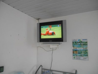 In the Suriname Consulate getting my visa sorted watching the start of the Netherlands v. Chile group decider!