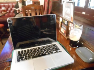 Getting online in the Traveller's Tavern with a Guinness.