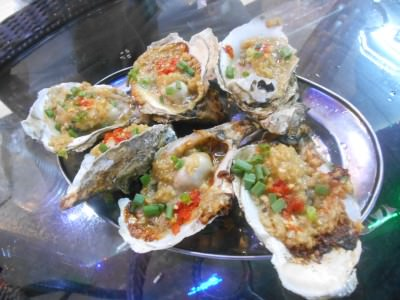 Yum! Spicy oysters in Da Lang, China.