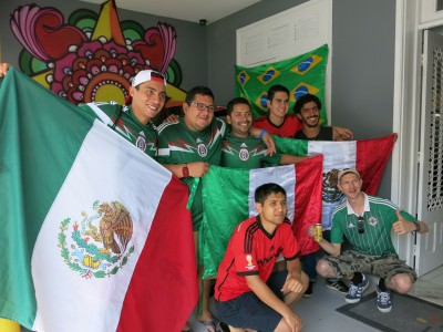 Posing with the Mexico fans in the J Sun Hostel the day of the big match v. Brazil.
