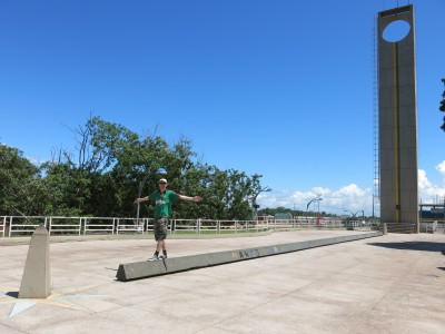 Standing on the equator in Macapa, Brazil.