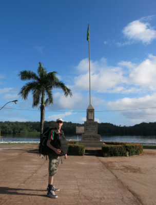 Monument and flag by the river.