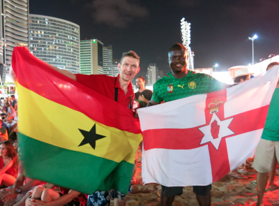 Flying the Ghana flag with Patrick while watching Cameroon v. Croatia at the Fan Fest.