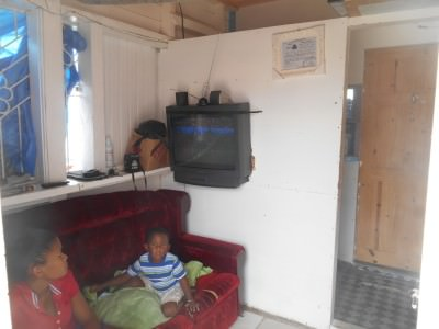Watching Netherlands v. Mexico is some guys house in Bartica, Guyana.