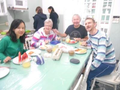 Family breakfast in Hostel Green House in Foz do Iguacu.