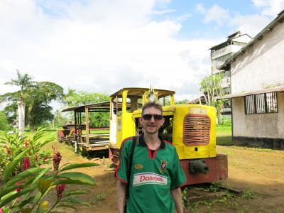 In front of the train which once transported sugar on Suriname's only railway.
