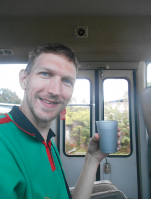 Enjoying my Suriname Cherry drink on the bus.
