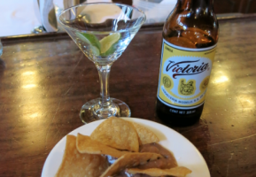 Free nachos , some cheese and beans with my Victoria beer and lime.
