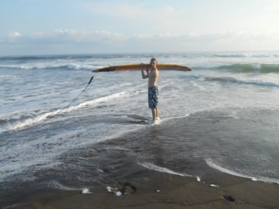 With the surfboard for my first surfing experience - waves of the Pacific Ocean in El Salvador.
