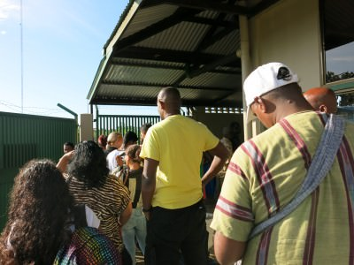 The queue for the ferry ticket leaving Suriname