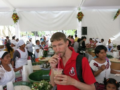 Sipping some nutty milky drink at the Tamal festival.