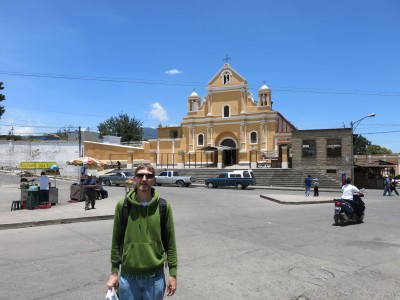 Outside the striking yellow Iglesia El Calvario.
