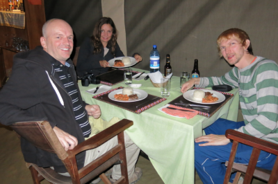 Raymond Walsh and I eating together on a night in the Serengeti in Tanzania.