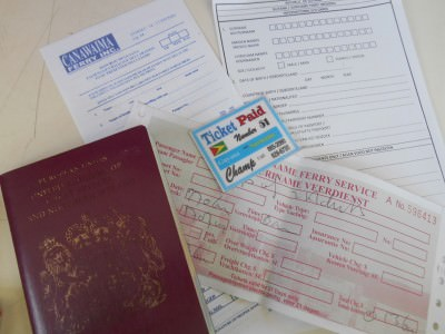 All the things you need - your passport - your ticket for Johnny's taxi and the 3 immigration forms.