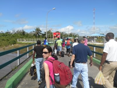 Panny walking off the boat into Guyana