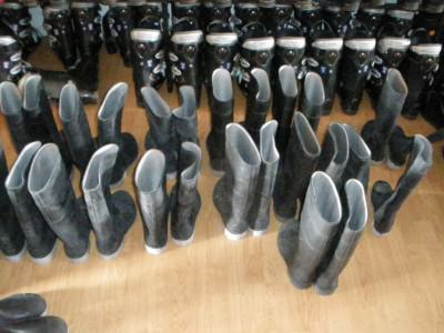 You can hire stuff in Ushuaia and most companies include wellies.