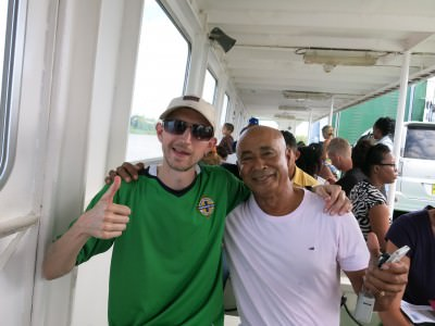 Chatting to some of the locals on the ferry across to Moleson Creek in Guyana.