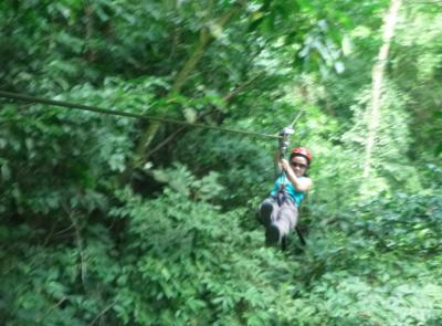 Panny ziplining in Rio Cangrejal, Honduras.