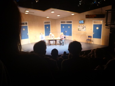 The play is set in a hostel on stage here.