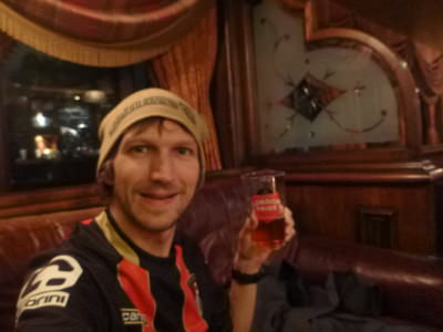 Enjoying my free beer at the Mad Hatter Hotel