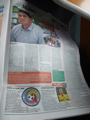 Newspaper with Romania v. Northern Ireland match preview.