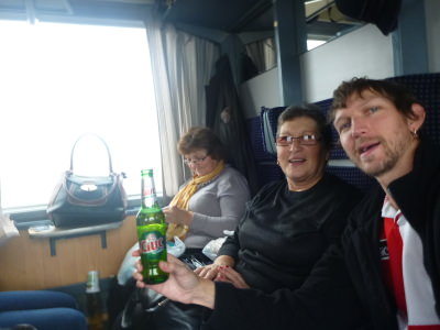 Having a beer on the train and chatting to the local ladies.