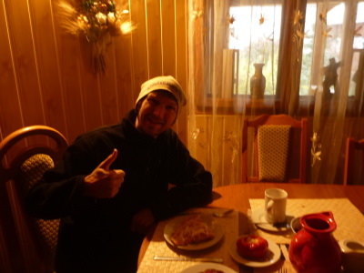 Enjoying a local breakfast at Dor de Bucovina Hostel.
