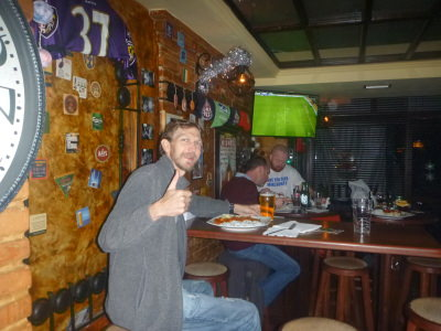 Watching the football with beer and curry in Pristina.