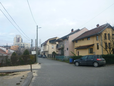 Buffalo Backpackers on a quiet street in Pristina.