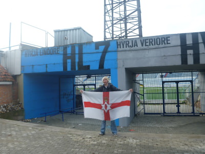 At the football stadium with my Northern Ireland flag.