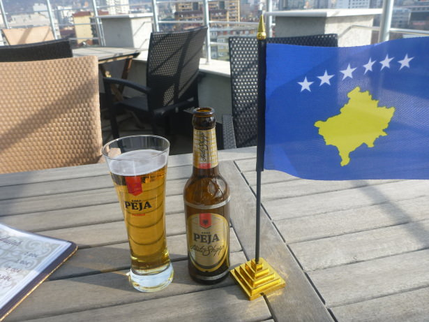 Beer and lunch with a view in Pristina, Kosovo.