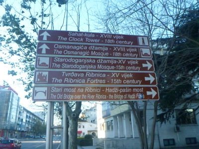 The sights of Podgorica condensed into one street sign.