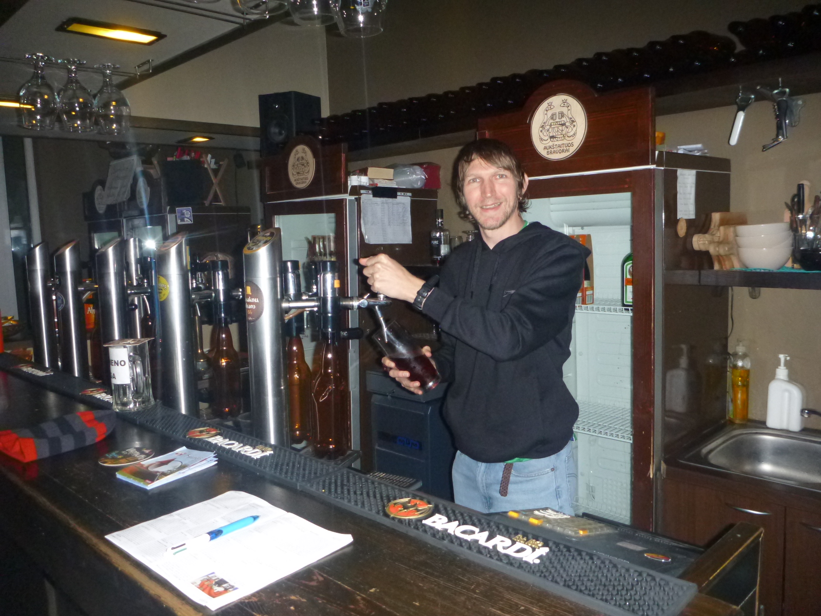 Behind the taps at Gyvas pub Kaunas Lithuania